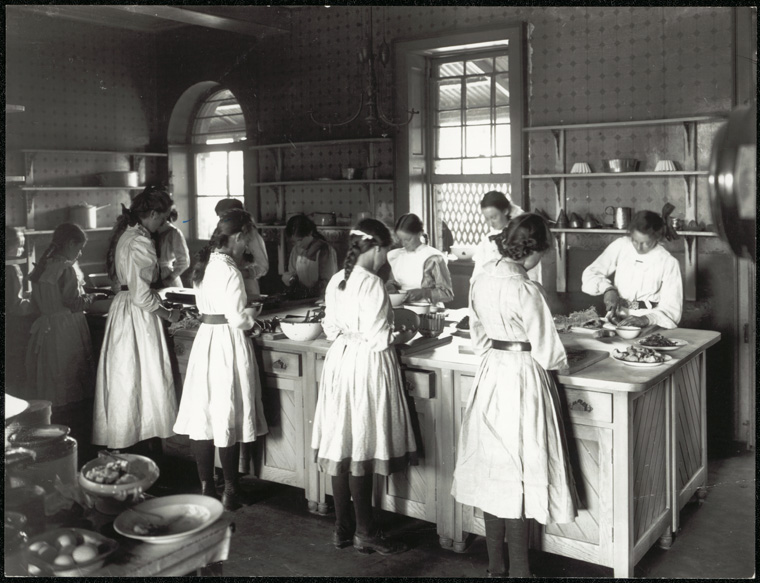 Black and white image of girls cooking.