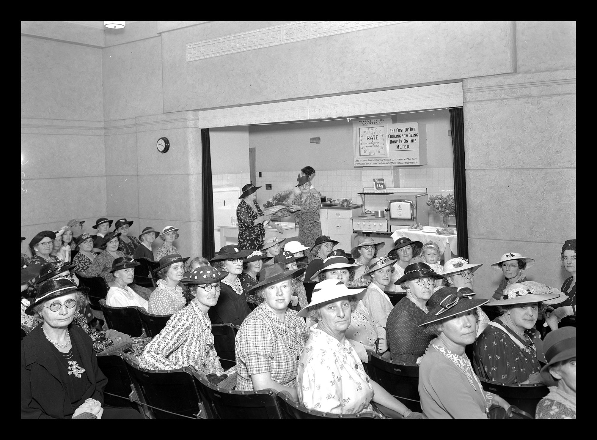 1930's photo of a room full of women wearing hats
