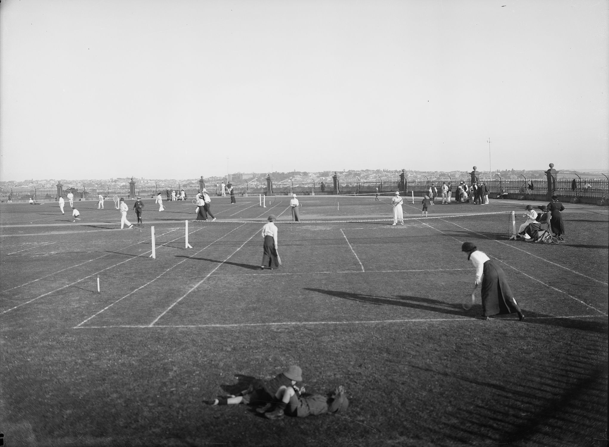 Archival photo of women playing tennis.