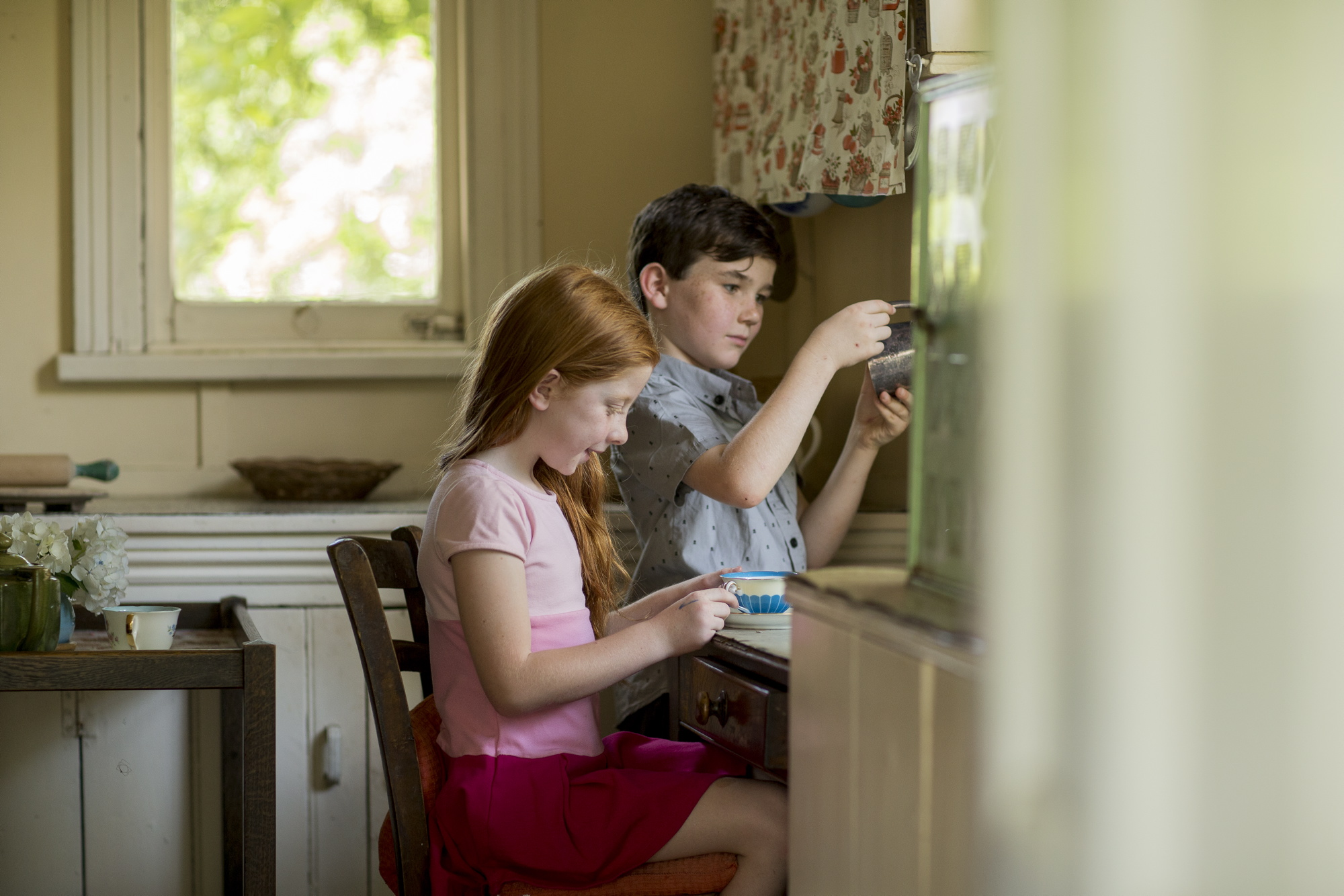 A boy and girl in the kitchen of Meroogal House