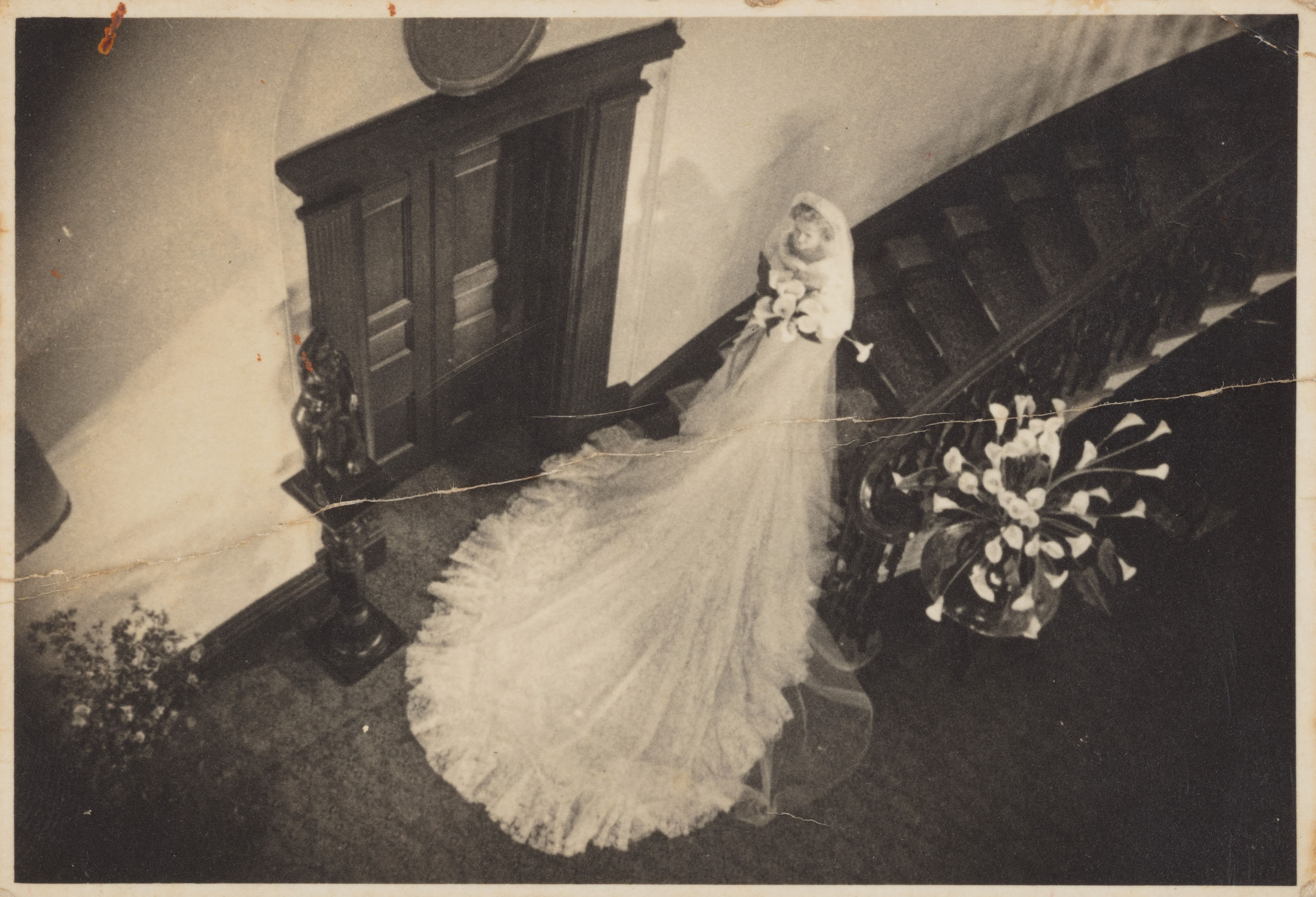 Photograph of Madge Elliott in her wedding dress on the staircase at Elizabeth Bay House, 16 September 1935.