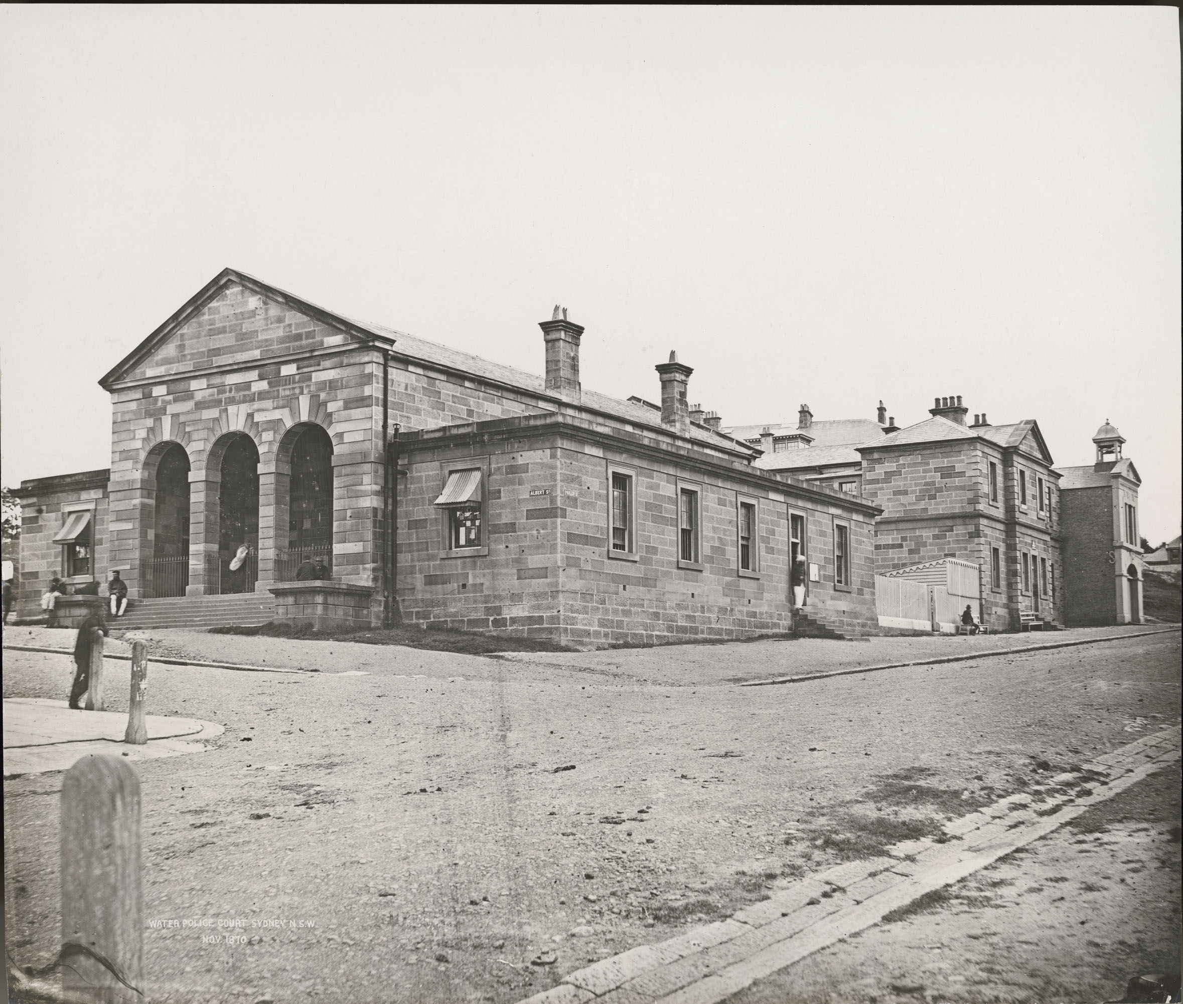 Black and white photograph depicting Phillip Street police station (Justice & Police Museum), corner of Phillip and Albert Streets, Sydney.