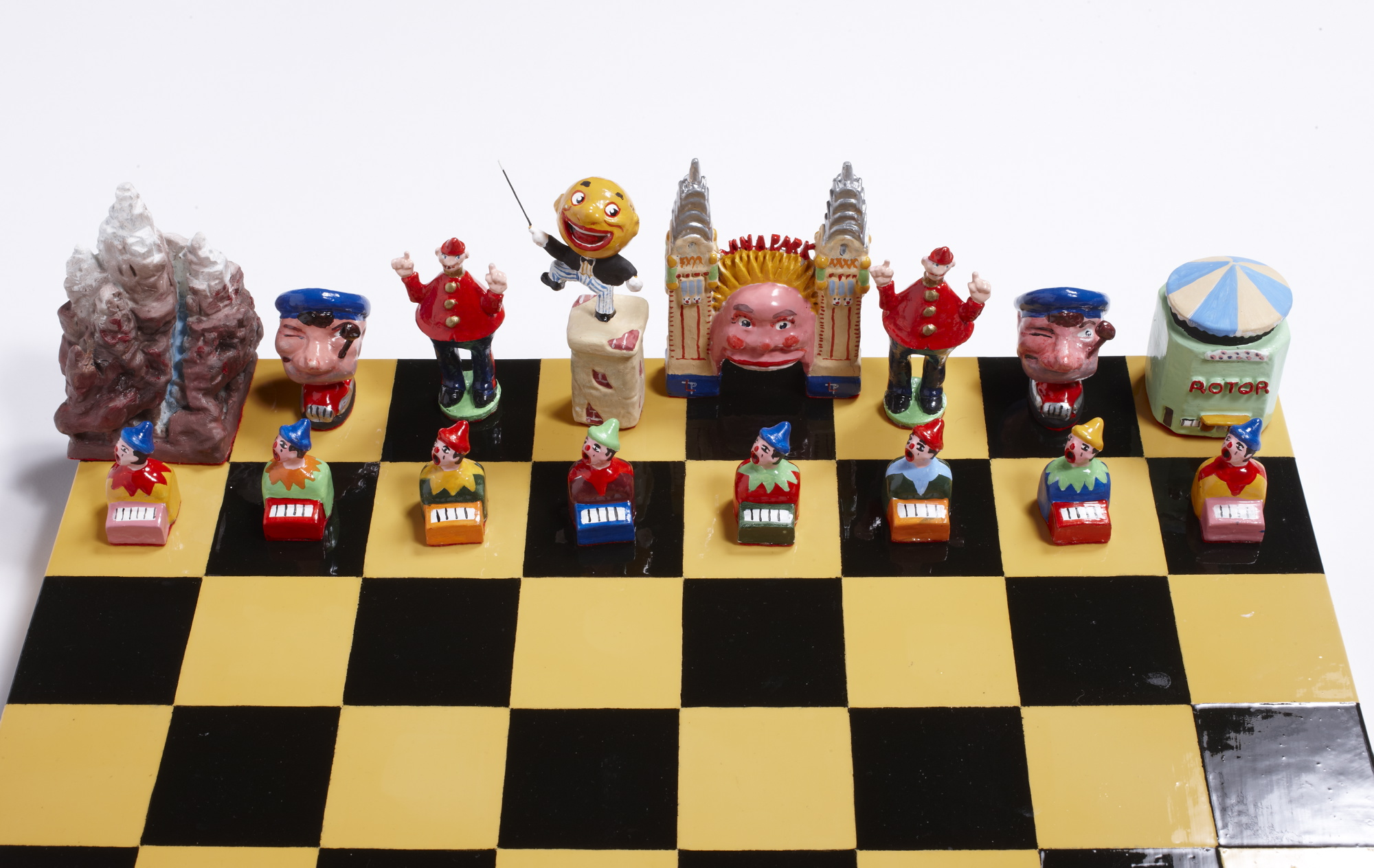 Hand made and painted chess set with pieces in shapes from Luna Park characters or rides.