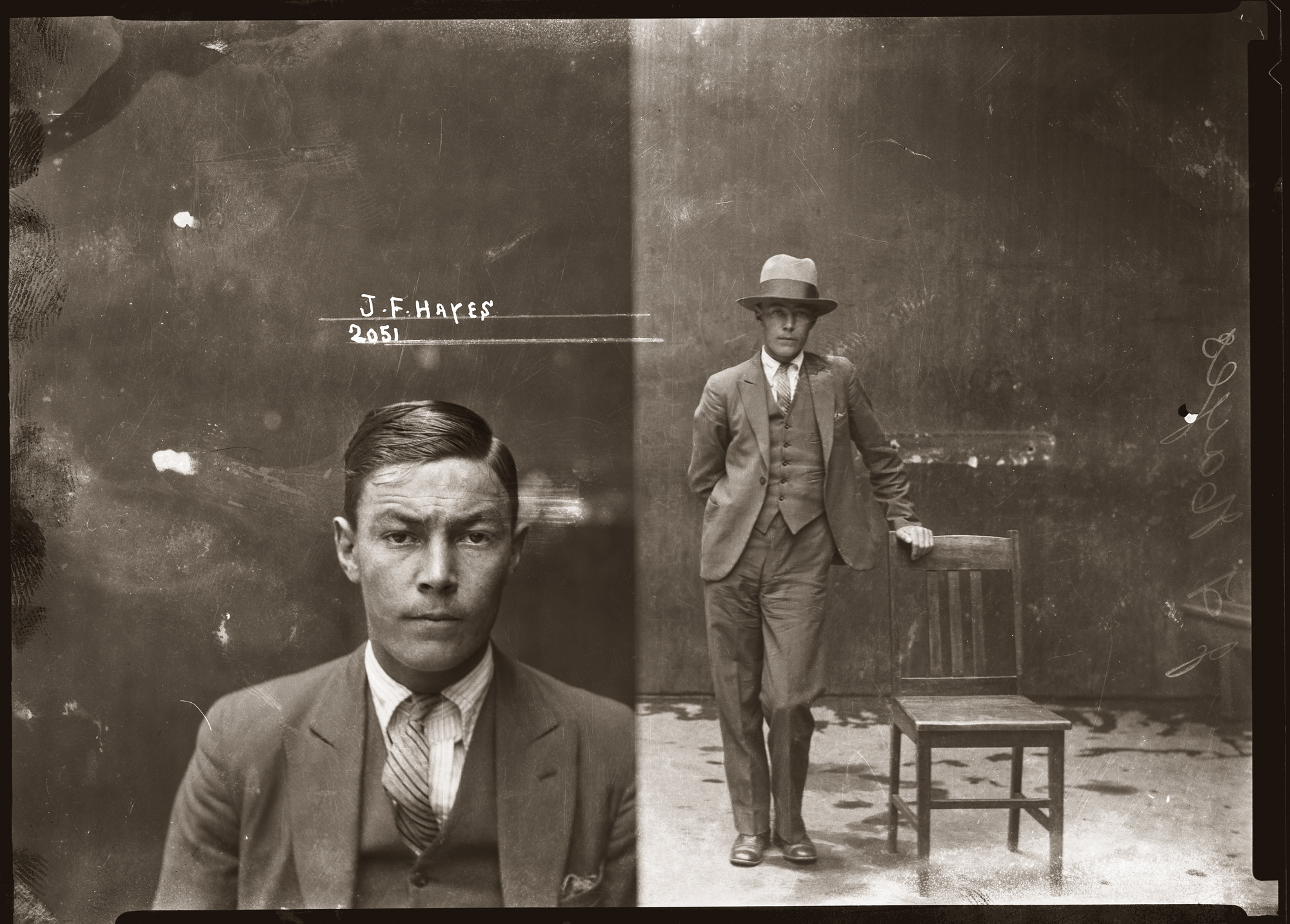 Black and white mugshot of man against wall, left hand side image closeup without hat, right hand side image full standing shot with hat on, leaning on chair.