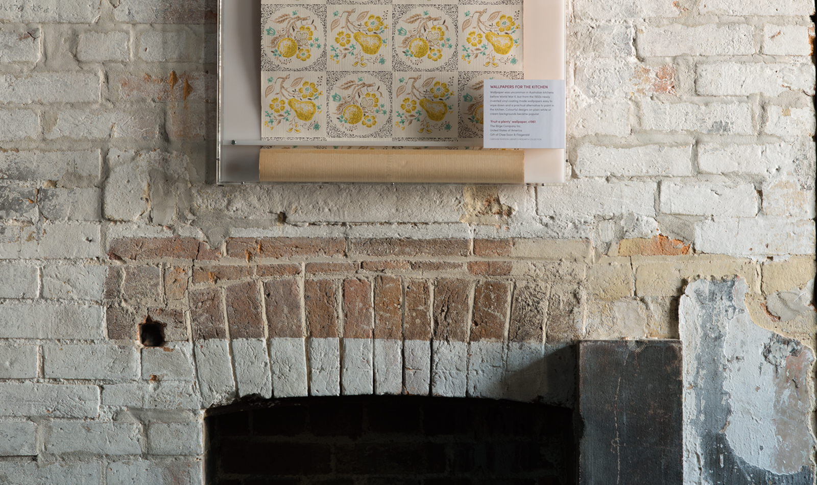 Brick fireplace with textured wallpaper image from The Caroline Simpson Library & Research Collection
