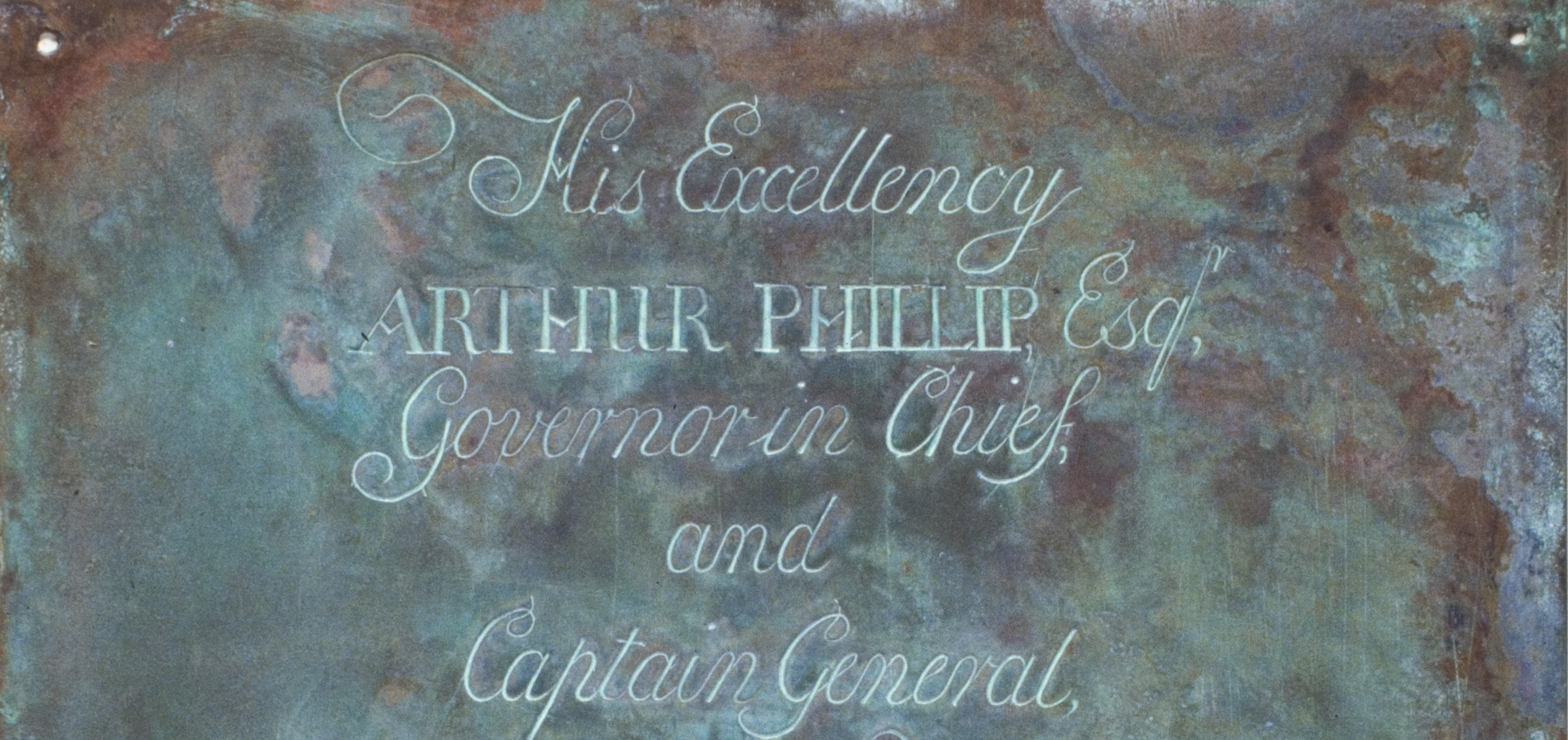 """Detail of copper plate engraved with the words """"His Excellency Arthur Phillip Esq. Governor in Chief and Captain General"""""""