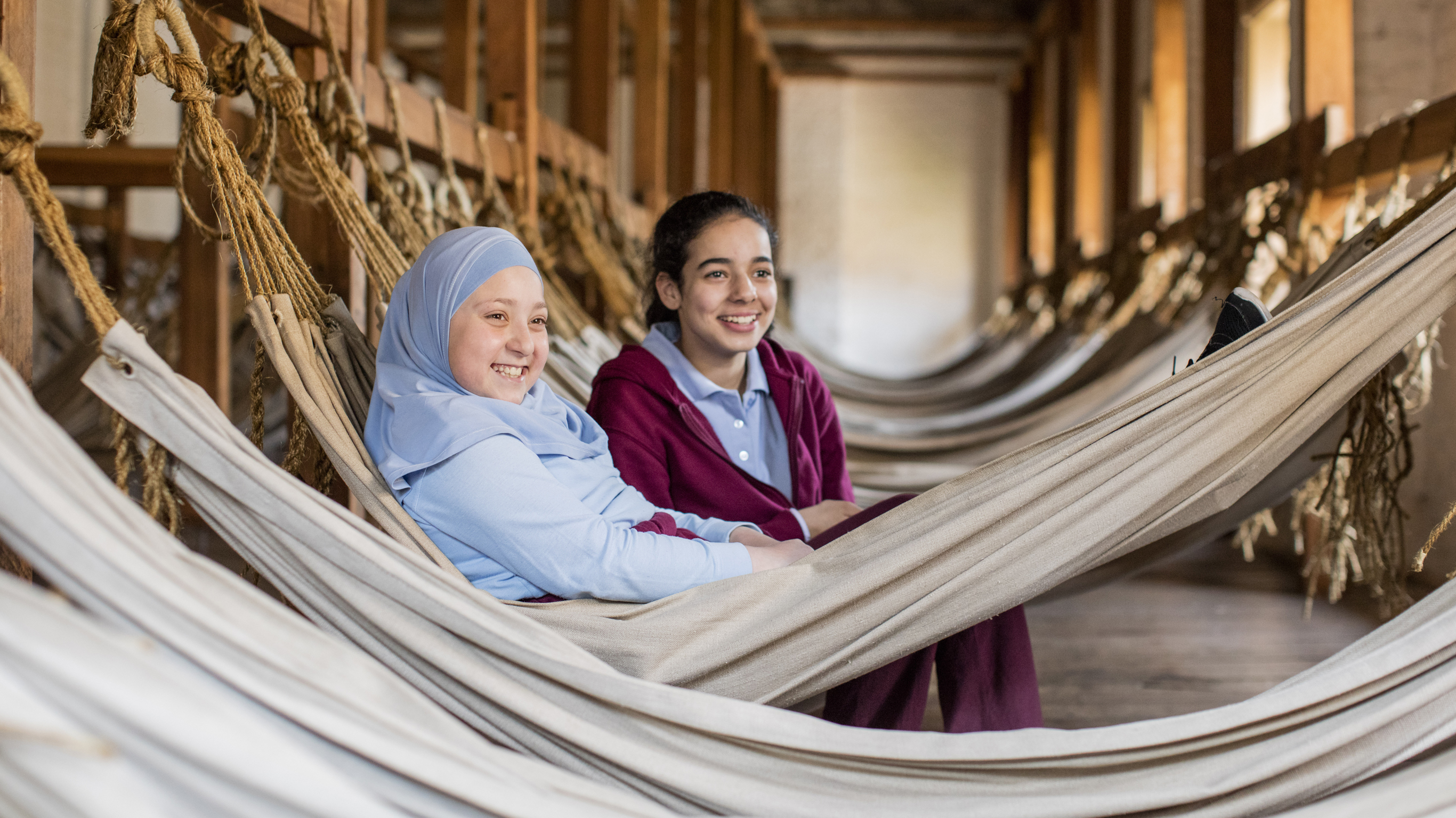 Two students in a hammock.