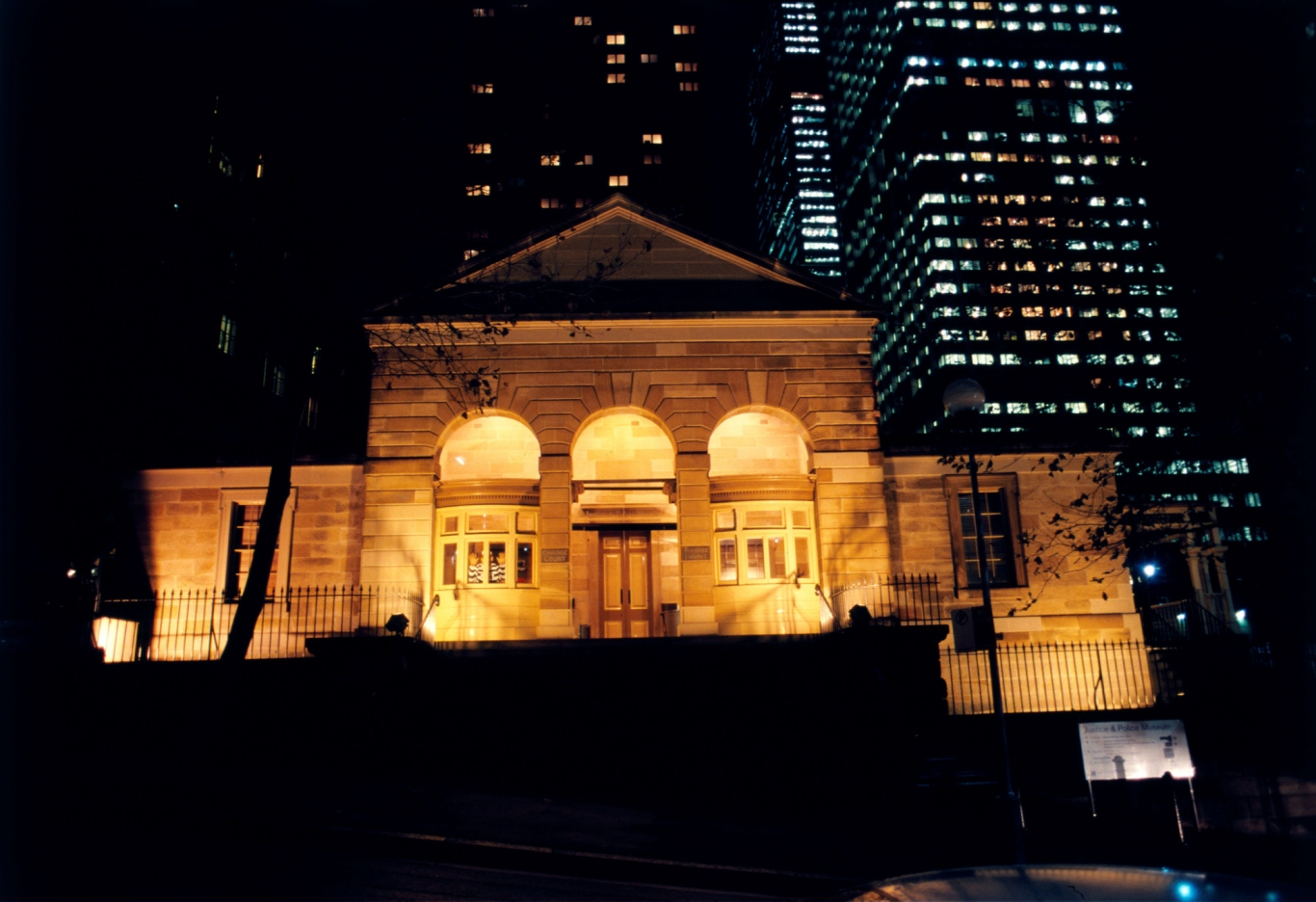 Exterior view of the Justice & Police Museum, former Water Police Court, Albert Street at night.