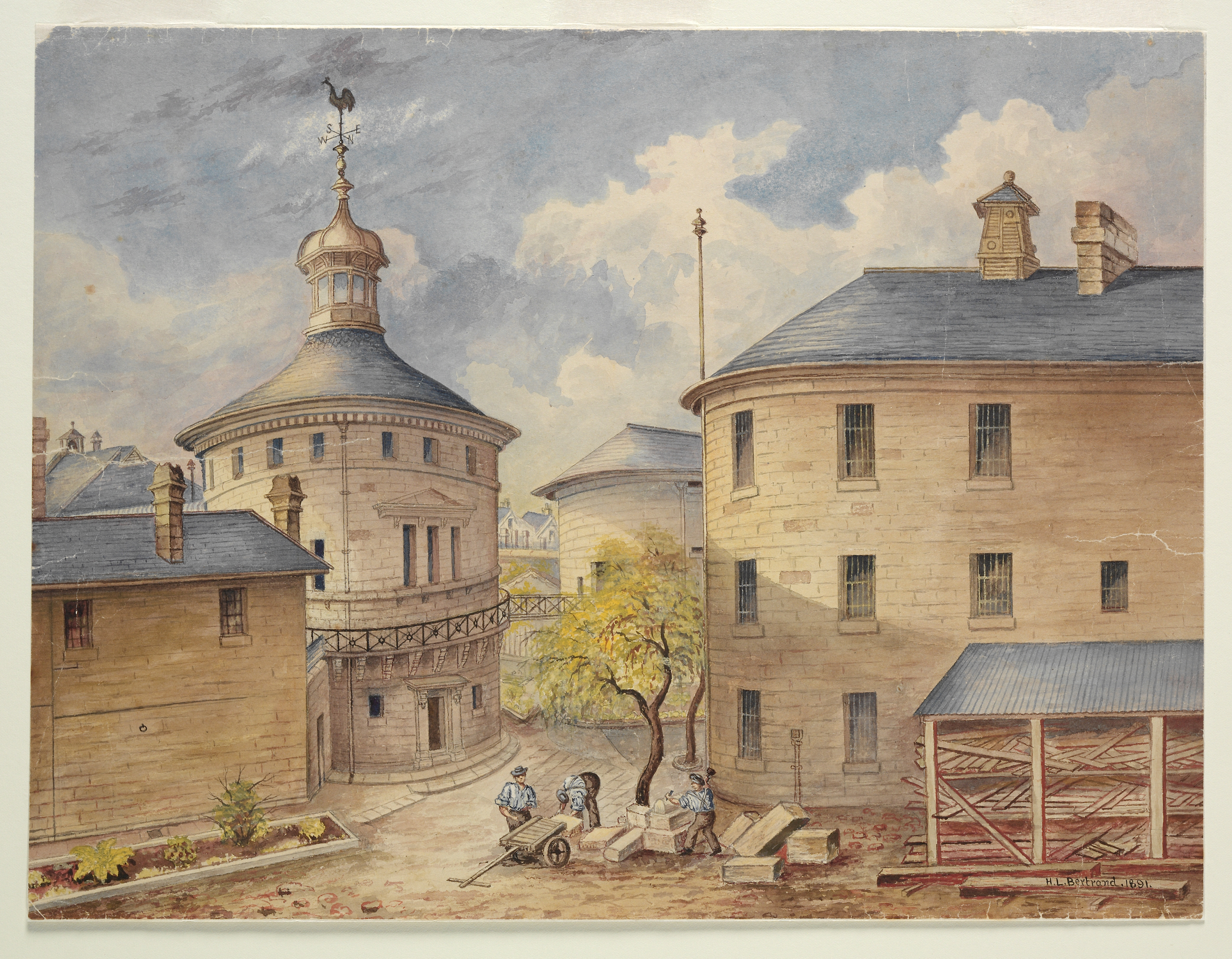 Painting showing convicts carving and moving sandstone blocks inside the gaol complex, the buildings arranged around a courtyard.
