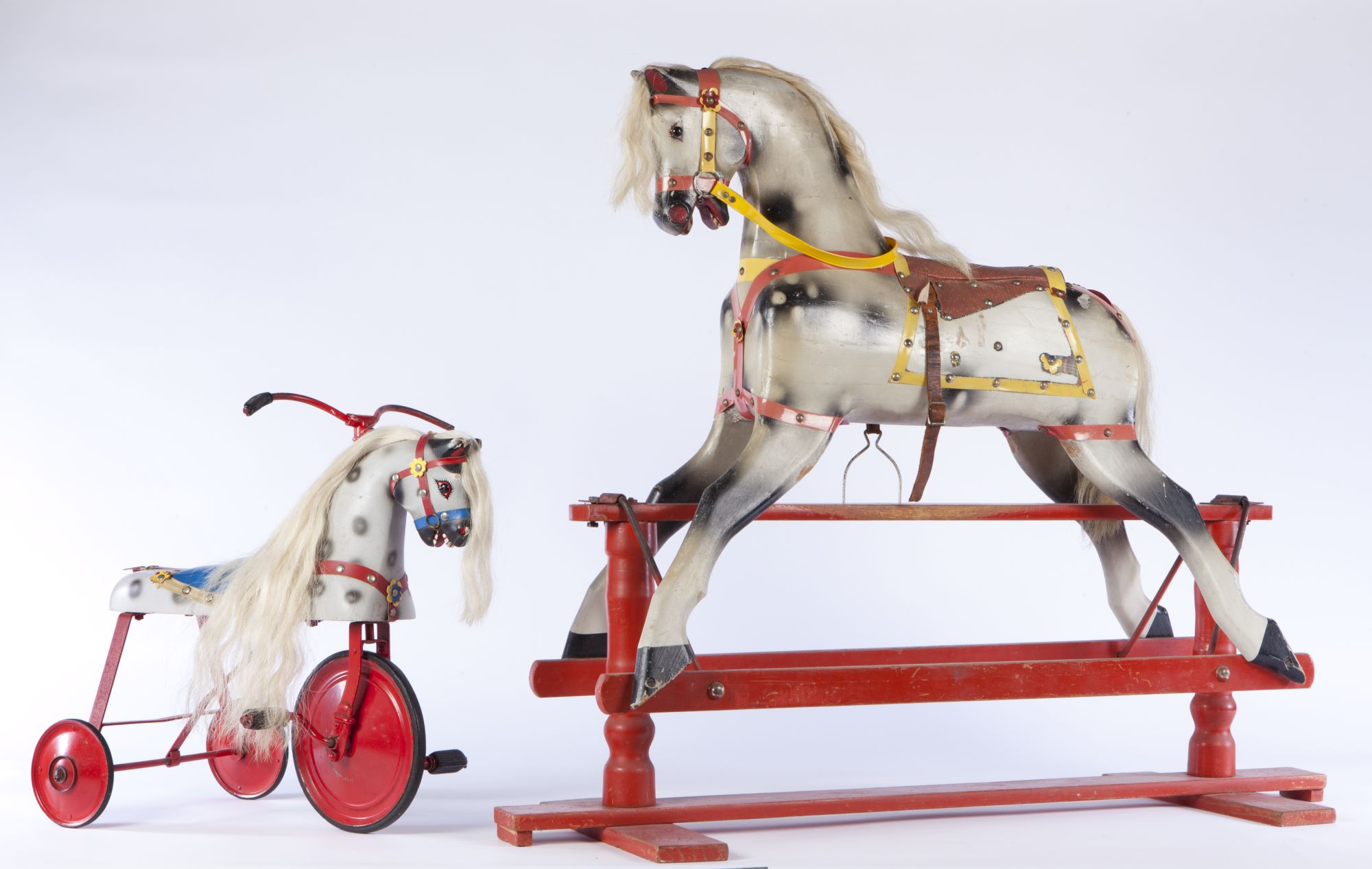 Two red vintage toys.