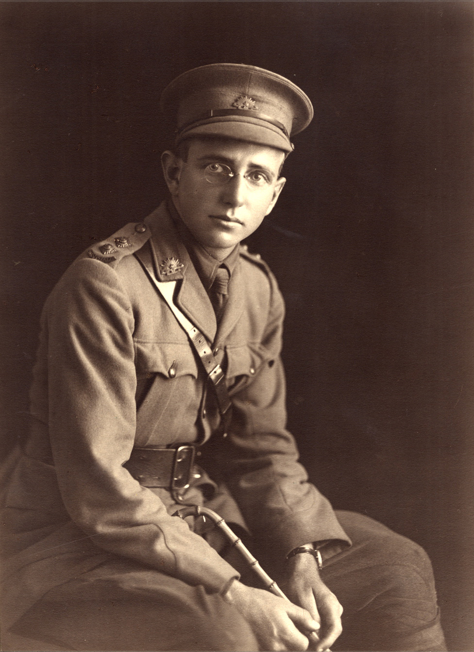 Black and white photograph of young bespectacled man in uniform