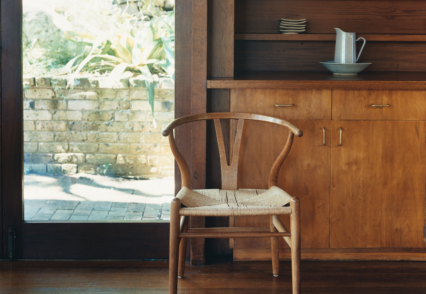 Image of timber chair and cupboards inside Marchall House