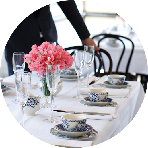 Circular crop of table setting with blue and white china cups.