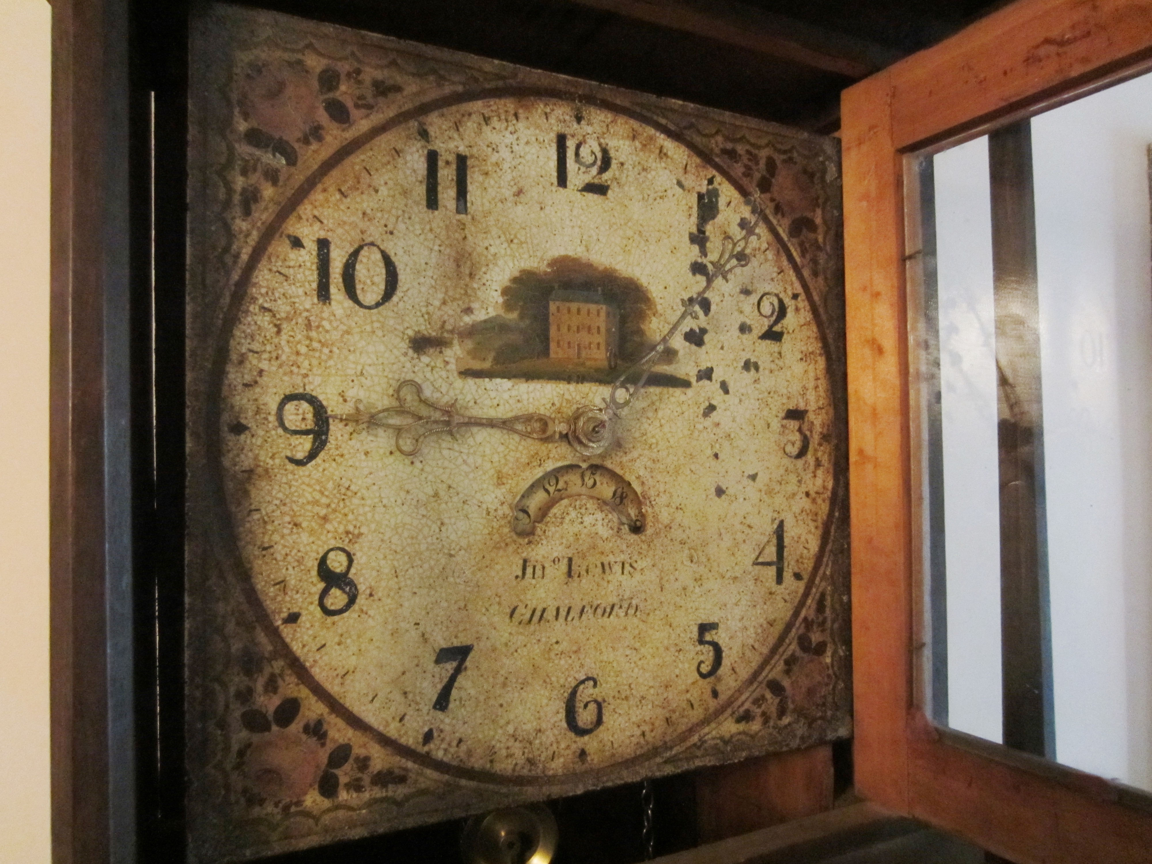 Close up of old clock face on grandfather clock