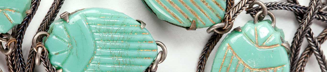 Detail view of an Egyptian-revival necklace