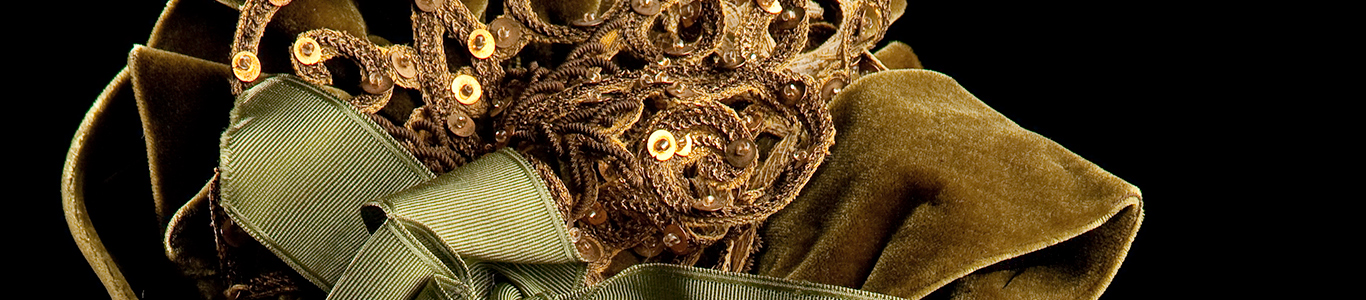 A stylish olive green silk velvet bonnet  elaborately trimmed with beads, gold braid, sequins and artificial pearls and has two silk ribbons draping from the back