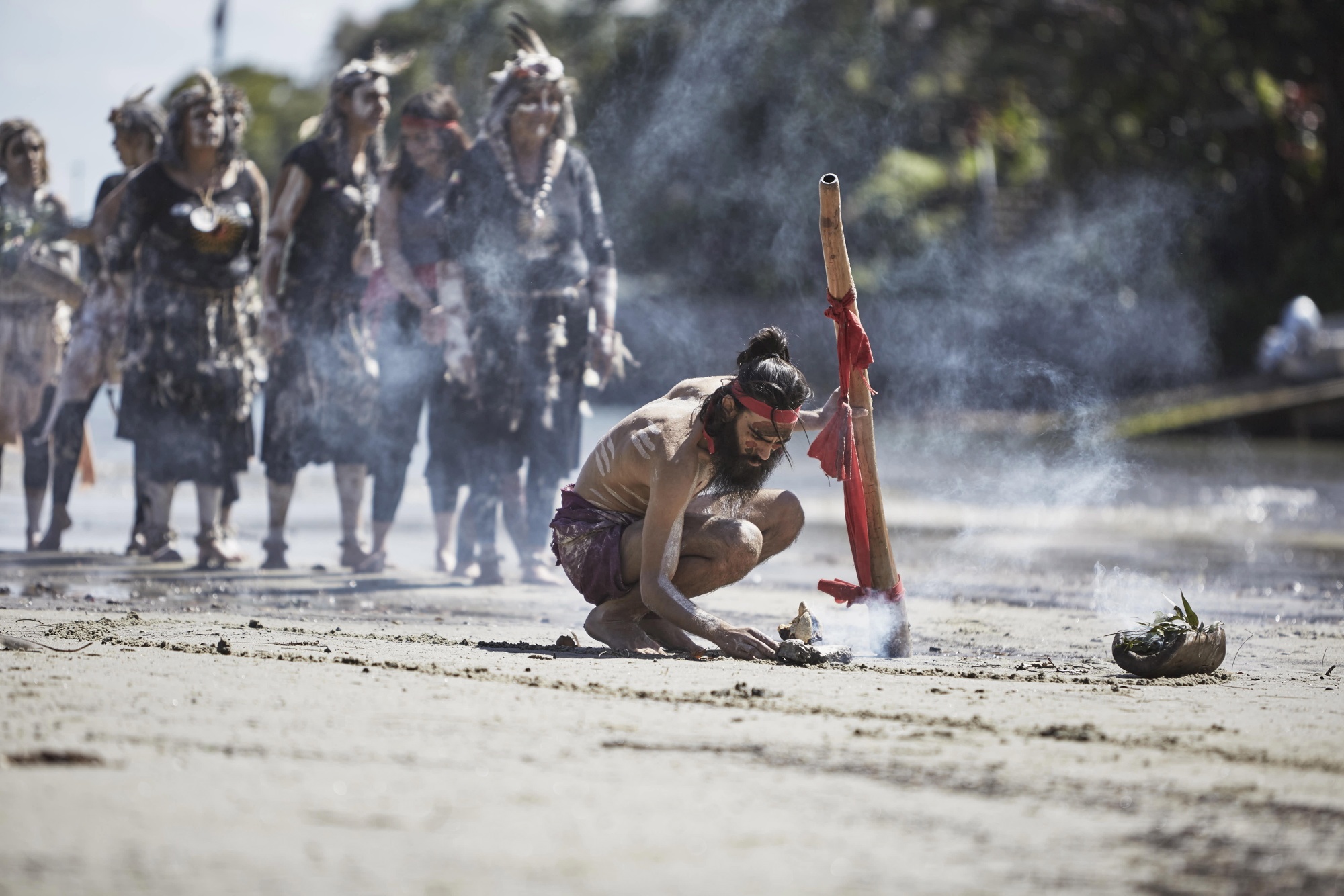 Dwayne 'Naja' Bannon-Harrison, from the Ngaran Ngaran dancers, performs the smoking ceremony