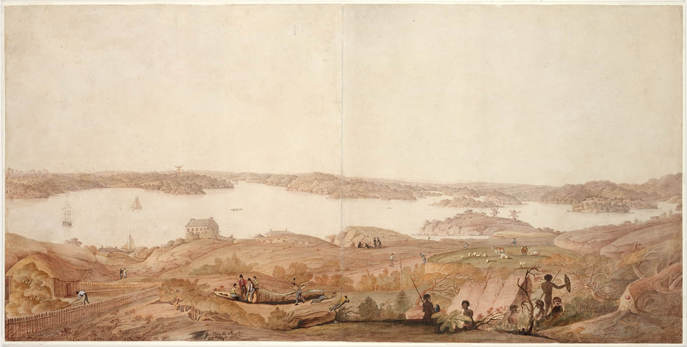 View of bay with Aboriginal people in foreground and a distant view of buildings along shore.