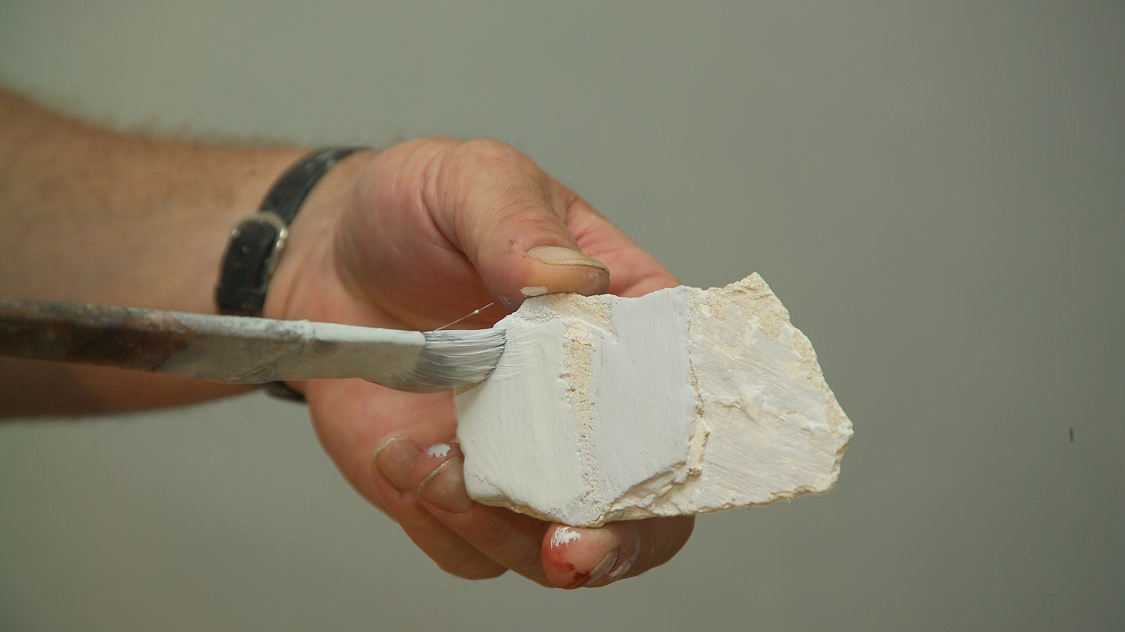 fragment of plaster with remnant paint traces