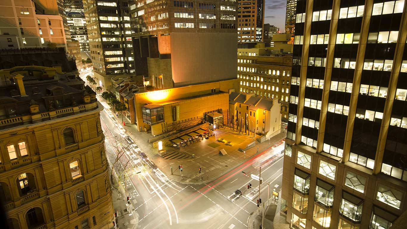 Image of the front of the Museum of Sydney shot from a high rise across the road.