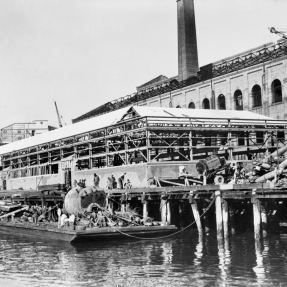 Exterior of the Royal Australian Navy (RAN) Torpedo Factory under construction, seen from the harbour. North Sydney, NSW C.1942.