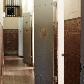 Interior photograph of prison cell corridor at the Justice and Police Museum.
