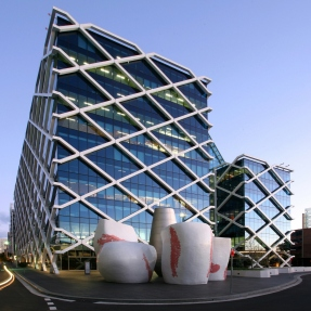Twin glass clad towers with diamond