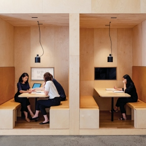 Two booths set into wall as workspaces.