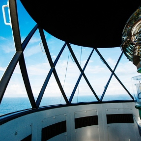 Looking out of diamond shaped glass panels of lighthouse.