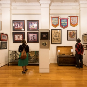 Sydney Open visitors view union banners in the Lorna Morrison room of Trades Hall.