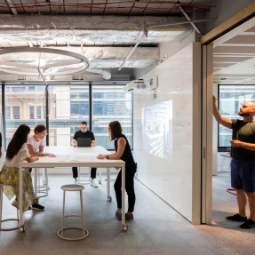 Interior photograph of BVN's Sydney Studio with people at work.