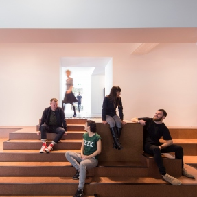 Interior photograph of Australian Design Centre, featuring staff and visitors in the gallery and events space.