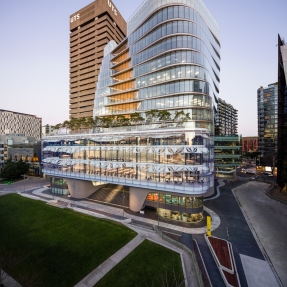 Exterior photograph of the new UTS Central building with the UTS tower visible behind it.