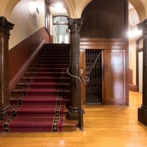 Interior photograph featuring the main stairs of Sydney Trades Hall.