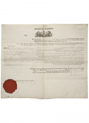 Image of a convict pardon. It has a red wax stamp in the lower left corner.