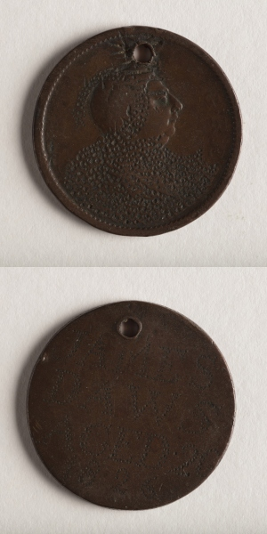 Stacked images of convict love token, front and back.