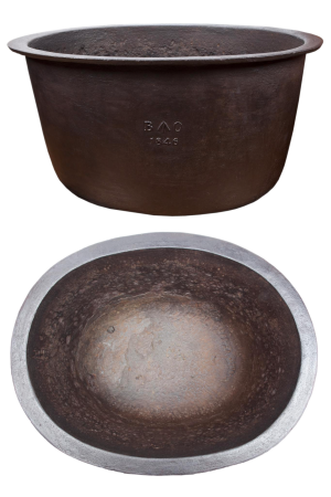 Composite image of a cauldron. One view from the front the other above.