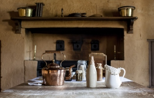 Some kitchen items on the table in front of the fireplace