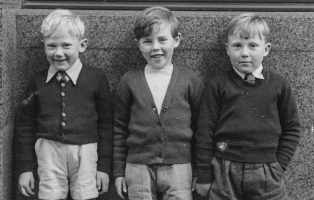 Black and white photo of three small boys.