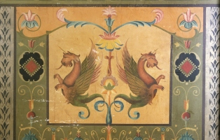 Detail from the dado in the entrance hall of house Valetta, 89 Crystal Street Petersham, showing painted decoration of a pair of mythical creatures (similar to griffins/gryphons).