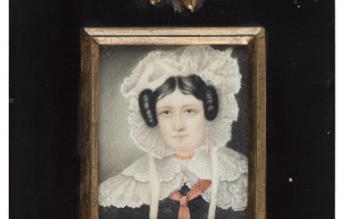 Portrait of woman in white bonnet and collar in black bordered frame.