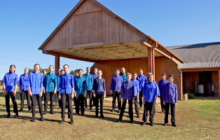 Sydney Children's Choir perform outside the stables at Rouse Hill Estate.