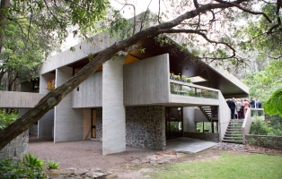 Modernist house with group on landing.