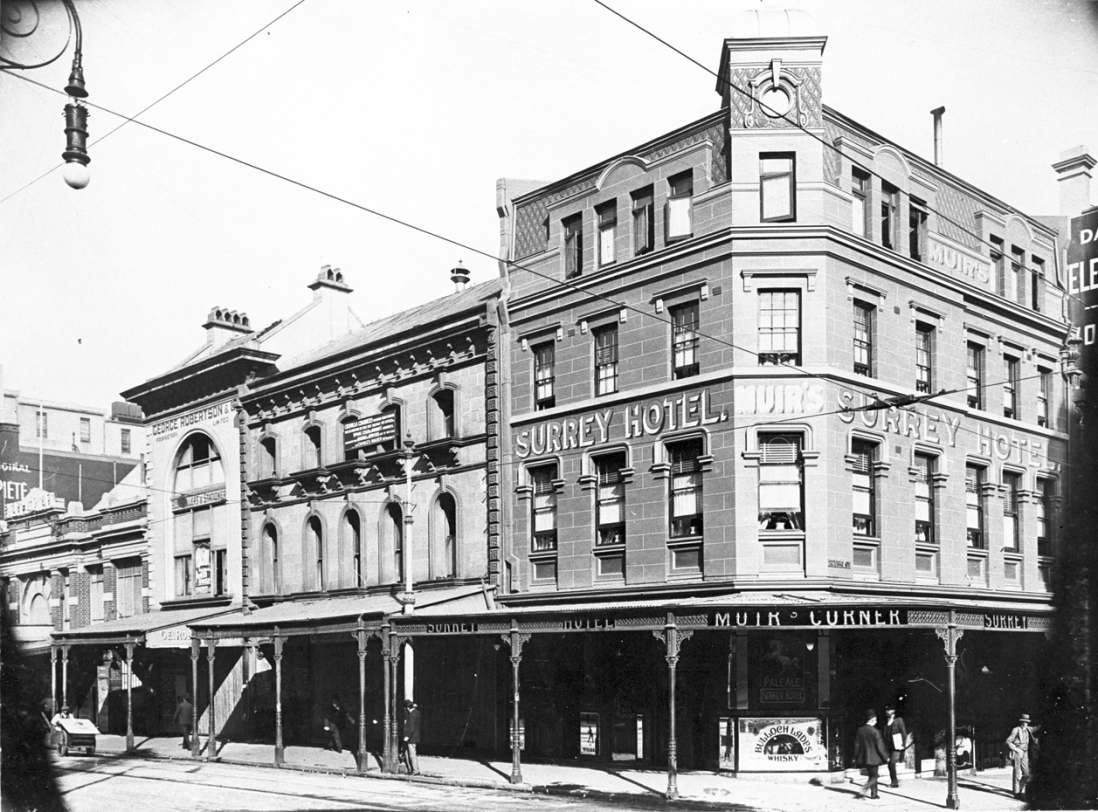 Exterior image of street showing four storey Victorian style building on a corner.