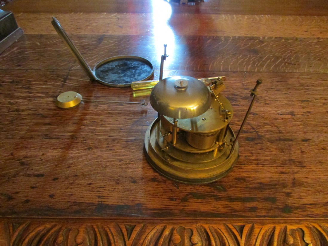 Internal workings of clock on table