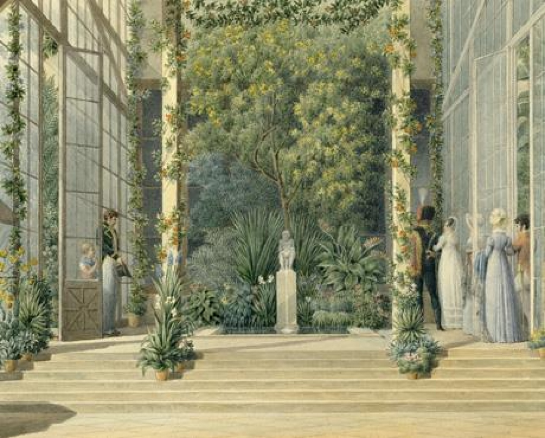 image of people in a large greenhouse at Malmaison filled with large plants and various potted plants.
