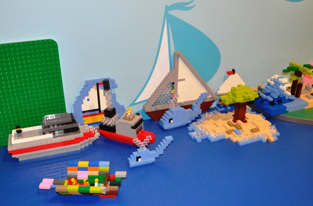 Models of ships and harbour icons.