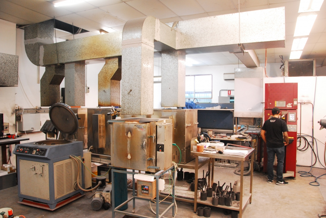 Interior of workshop with equipment and supplies.