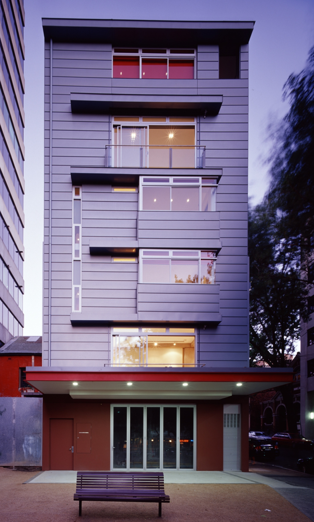 Exterior photograph of Substation No. 175 in Surry Hills featuring building's western facade at dusk.