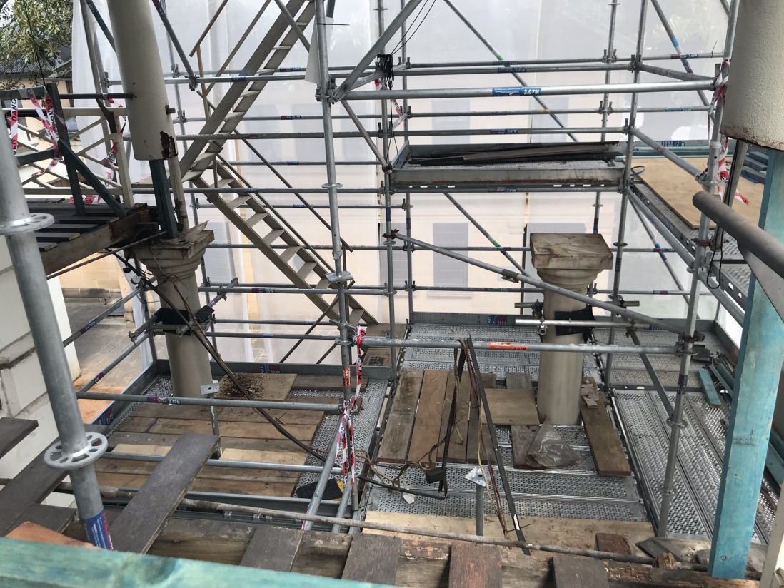 Southwest end of building showing top sections of columns to be repaired